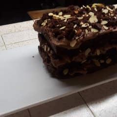 Chocolate Cake with Strawberry and almond layers.
